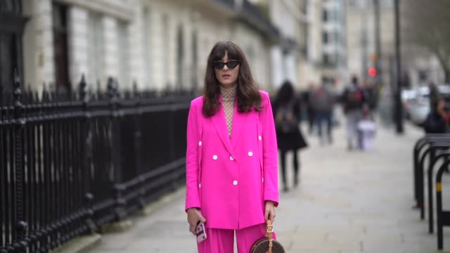 eleonora carisi wears a pink blazer jacket suit pants white shoes sunglasses a vuitton circular bag during london fashion week february 2018 on... - london fashion week stock videos and b-roll footage