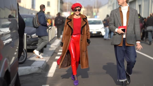Eleonora Carisi wears a red beret hat a red outfit during Milan Menswear Fashion week Fall/Winter 2018/19 on January 14 2018 in Milan Italy