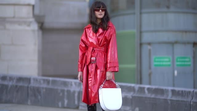 eleonora carisi wears sunglasses a red pvc coat a white semi circular bag outside elie saab during paris fashion week womenswear fall/winter... - pvc stock videos and b-roll footage