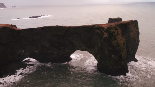 elephant rock scenery in dyrholaey, iceland - natural arch stock videos & royalty-free footage