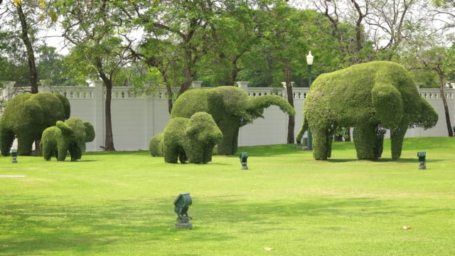 Elephant shaped bushes on garden grounds of Bang Pa-In Royal Palace in Ayutthaya, Thailand