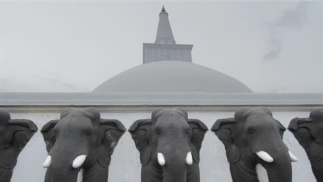 ms elephant statues guard ruwanwelisaya dagoba or stupa / anuradhapura, north central province, sri lanka - sri lankan culture stock videos & royalty-free footage
