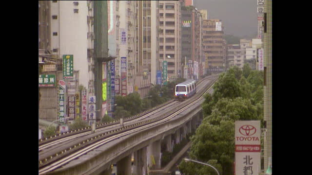 elevated metro train passes through taipei cityscape; 1996 - 1996 stock videos & royalty-free footage
