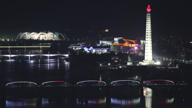 elevated night view showing landmark buildings in pyongyang north korea - pyongyang stock videos and b-roll footage