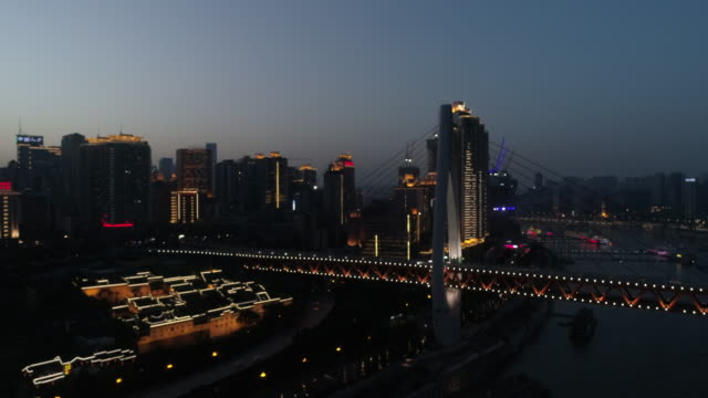 r/t ws ha elevated shot of tourboat on yangtze river craning to urban city skyline at night / chongqing, china - ship's bridge stock videos & royalty-free footage