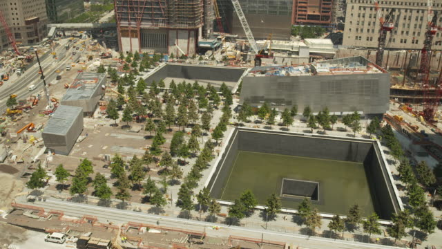 elevated, static shot showing the national september 11 memorial & museum whilst under construction in summer 2011, manhattan, new york city, usa. - 2001 stock videos and b-roll footage