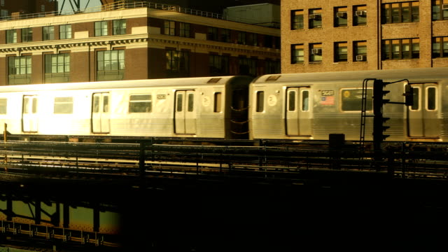 elevated subway train and office buildings - queens new york city stock videos & royalty-free footage
