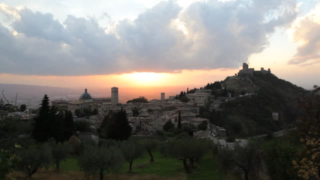 elevated sunset over olive groves assisi, umbria, italy, europe - assisi stock videos and b-roll footage