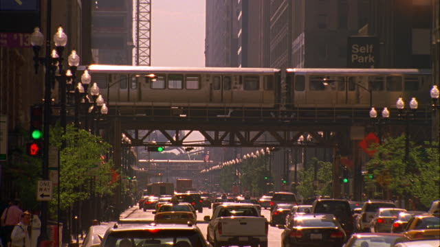 MS, Elevated train and traffic on street, rear view, Chicago, Illinois, USA