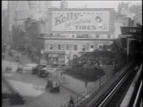 1915 ws elevated train crossing bridge over city street / new york city, new york united states - commercial sign stock videos and b-roll footage