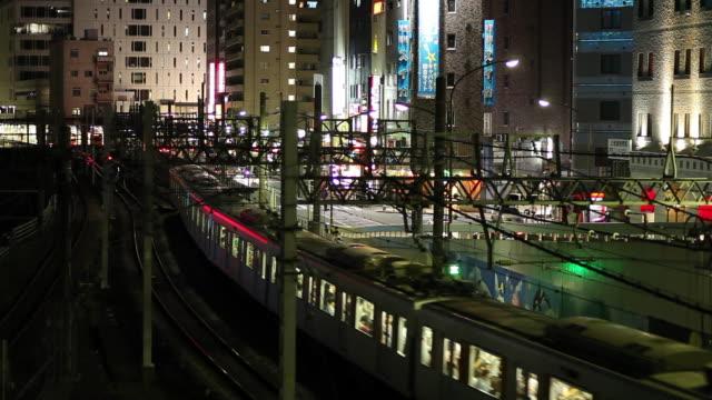 WS HA Elevated train crossing city at night / Tokyo, Japan