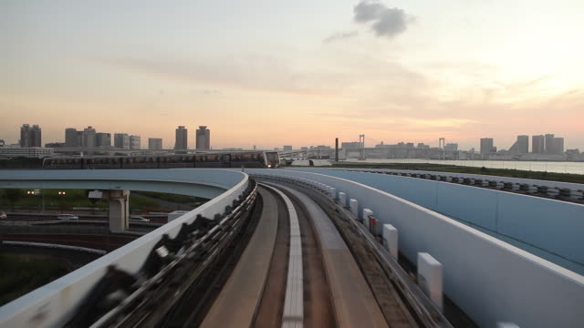pov ws elevated train crossing city at sunrise / tokyo, japan - diminishing perspective stock videos & royalty-free footage