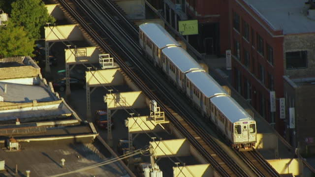 WS AERIAL POV ZO Elevated train moving on railway bridge near Illinois Medical District / Chicago, Cook County, Illinois, United States