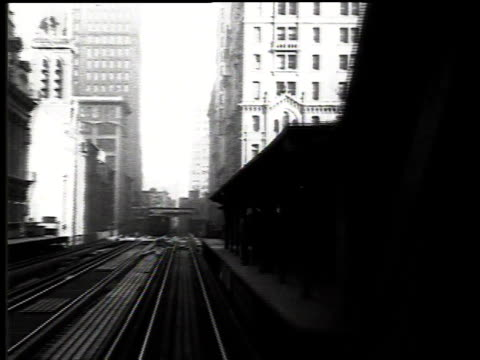 1916 pov elevated train passing stations with people waiting on the platforms / new york, new york, united states - 1916 stock videos & royalty-free footage