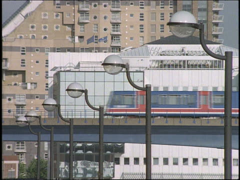 elevated train past buildings / london - elevated train stock videos & royalty-free footage