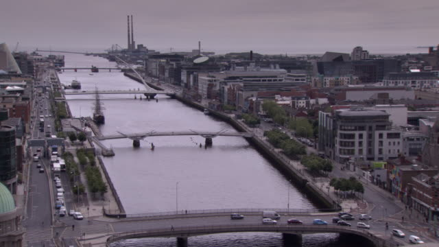 elevated, treated view of the river liffey stretching to dublin bay on the horizon, republic of ireland. - sean o'casey stock videos and b-roll footage