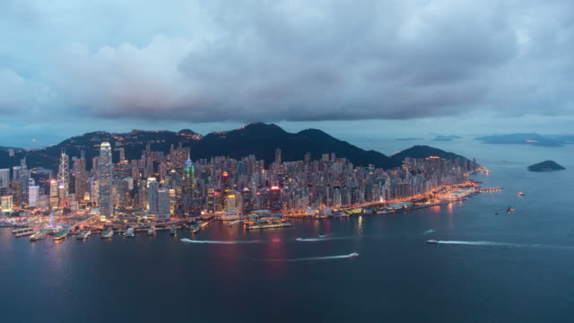 elevated view across the busy hong kong harbour, central district of hong kong island and victoria peak, hong kong, china - hong kong island stock videos & royalty-free footage