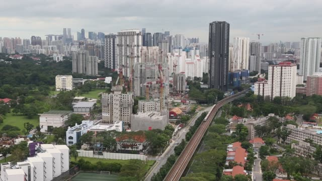 Elevated view an elevated train track is seen near residential and commercial buildings stand in Queenstown estate in Singapore on Monday Jan 15 2018