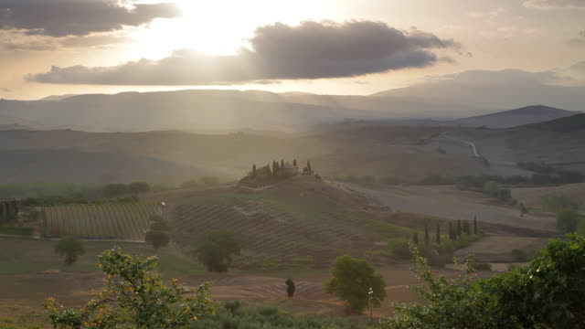 Elevated view Farmhouse in the Val d Orcia, Tuscany, Italy, Europe, T/Lapse