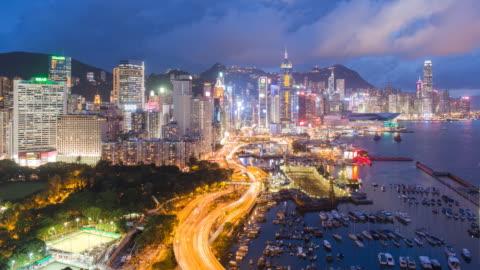 elevated view, harbour and central district of hong kong island and victoria peak, hong kong, china - hong kong island stock videos & royalty-free footage