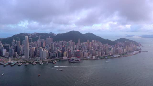 elevated view, harbour and central district of hong kong island and victoria peak, hong kong, china - hong kong island stock videos & royalty-free footage