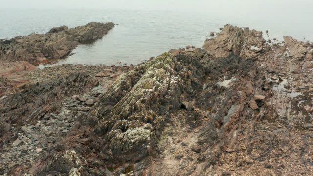 elevated view of a rough rocky a scottish shore - johnfscott stock videos & royalty-free footage