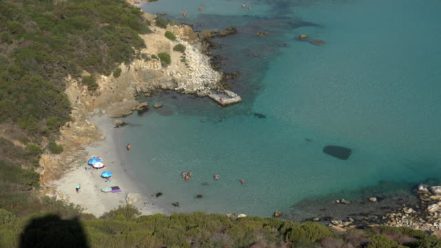elevated view of bay at villasimius beach - spiaggia stock videos & royalty-free footage