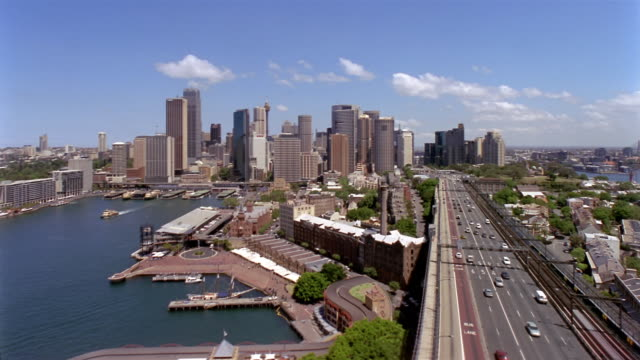 Elevated view of Bradfield Highway, Circular Quay on Sydney Cove, and skyline / Sydney, Australia