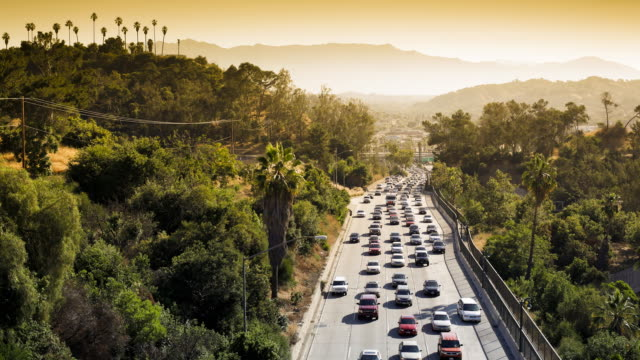 elevated view of busy traffic on the pasadena freeway, los angeles, california, united states of america, time-lapse - pasadena los angeles video stock e b–roll