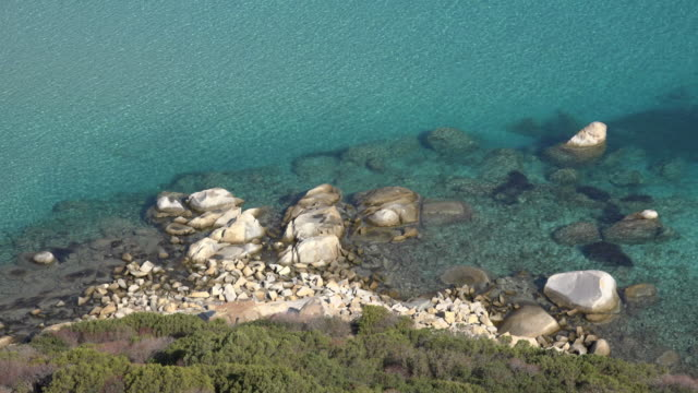 elevated view of coast at villasimius beach - spiaggia stock videos & royalty-free footage