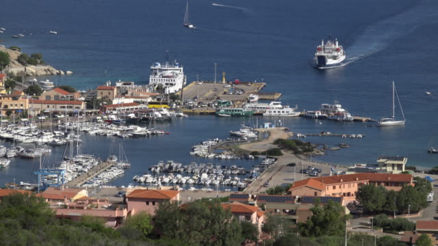 elevated view of ferry arrives in palau harbor - sassari stock videos & royalty-free footage