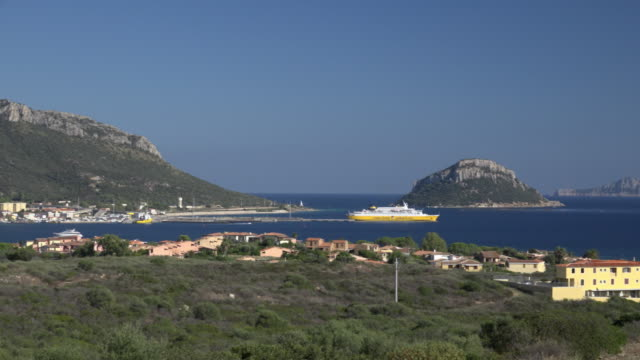 pan / elevated view of ferry leave golfo aranci - sassari stock videos & royalty-free footage