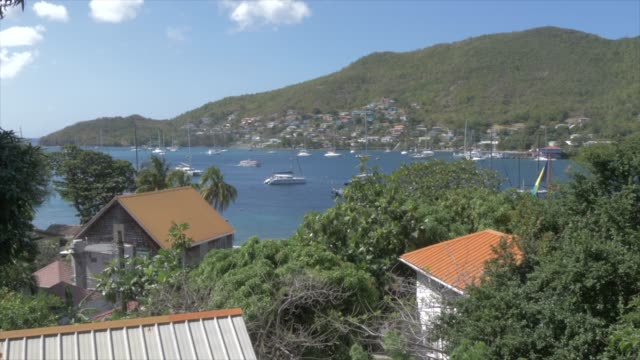 elevated view of harbour in port elizabeth, bequia, st. vincent and the grenadines, west indies, caribbean, central america - film tilt stock videos & royalty-free footage