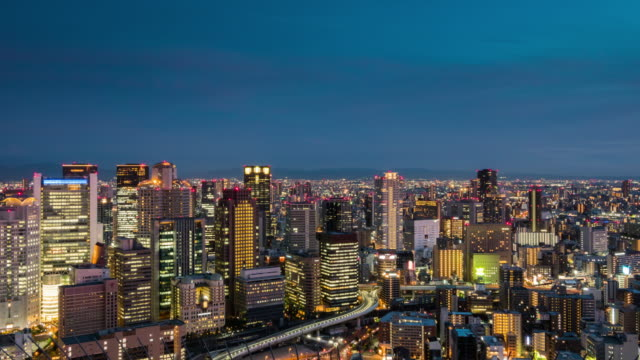 elevated view of osaka urban sunset skyline during rush hour from dusk to night - square stock videos & royalty-free footage