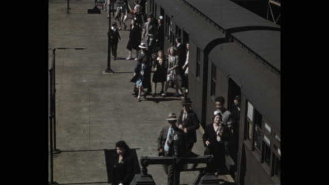 elevated view of passengers leaving train at coney island-stillwell avenue station, new york city, ny, usa - 1941 stock videos & royalty-free footage