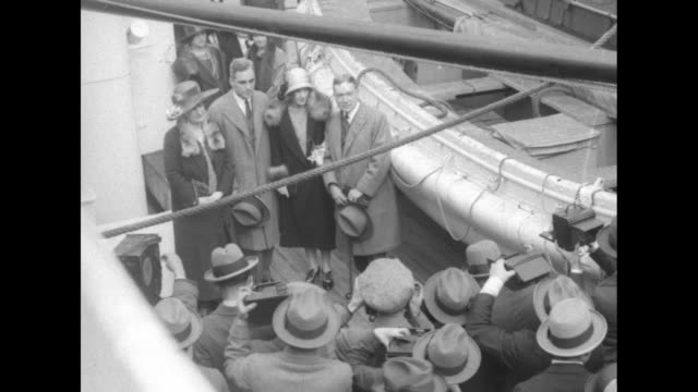 elevated view of people on deck with a cameraman and photographers; l-r abigail rockefeller, john d. rockefeller jr., daughter abigail aldrich... - passenger ship stock videos & royalty-free footage