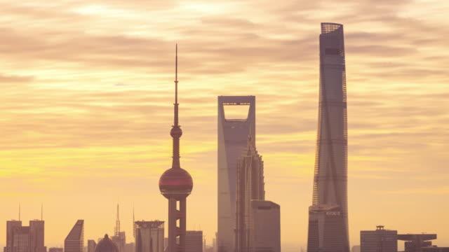 elevated view of shanghai landmark towers sun glowing transition - 東方明珠塔点の映像素材/bロール