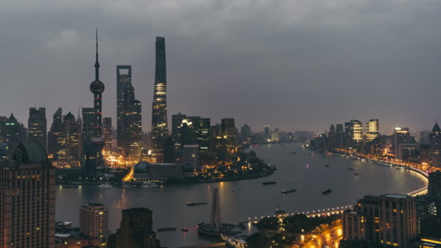 t/l ws ha tu elevated view of shanghai skyline, dawn to day transition / shanghai, china - dawn to day stock videos & royalty-free footage