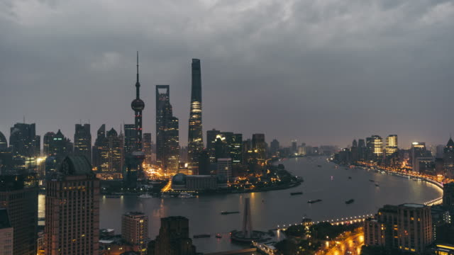 t/l ws ha zi elevated view of shanghai skyline, dawn to day transition / shanghai, china - dawn to day stock videos & royalty-free footage