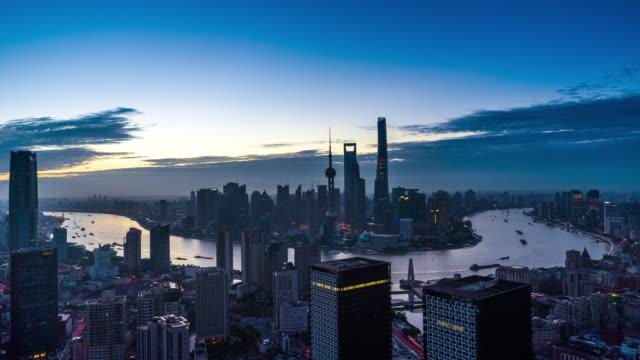 elevated view of shanghai urban cityscape dawn to sunrise transition - 東方明珠塔点の映像素材/bロール