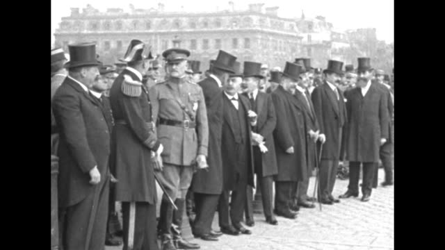 elevated view of the arc de triomphe with american troops marching by / dignitaries walk forward to a small table with a pillow resting on it at the... - arc de triomphe paris stock videos & royalty-free footage