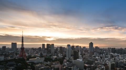 t/l ws ha pan elevated view of tokyo urban sunset skyline during rush hour from dusk to night - tokyo japan stock videos & royalty-free footage