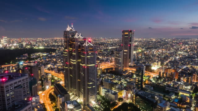 elevated view of tokyo urban sunset skyline during rush hour from dusk to night - square stock videos & royalty-free footage