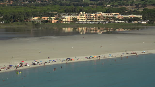 elevated view of tourists and hotel at villasimius beach - spiaggia stock videos & royalty-free footage