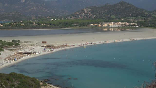 zo / elevated view of tourists at villasimius beach - spiaggia stock videos & royalty-free footage