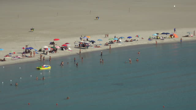 elevated view of tourists at villasimius beach - spiaggia stock videos & royalty-free footage