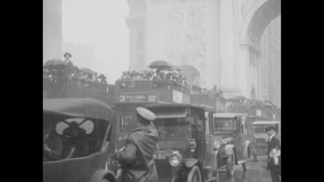 elevated view of traffic and pedestrians under umbrellas with overcrowded buses and doubledecker buses / cars and hundreds of people atop the buses... - passing a note stock videos & royalty-free footage