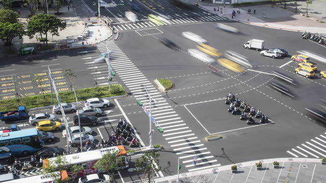 elevated view of traffic at a junction / taipei, taiwan - taipei stock videos & royalty-free footage