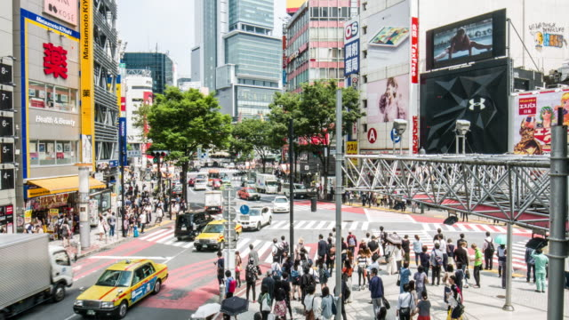 elevated view of traffic in the streets of tokyo - crosswalk sign stock videos & royalty-free footage