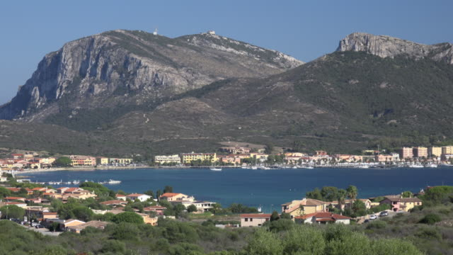 zo / elevated view of village and harbor of golfo aranci - sassari stock videos & royalty-free footage